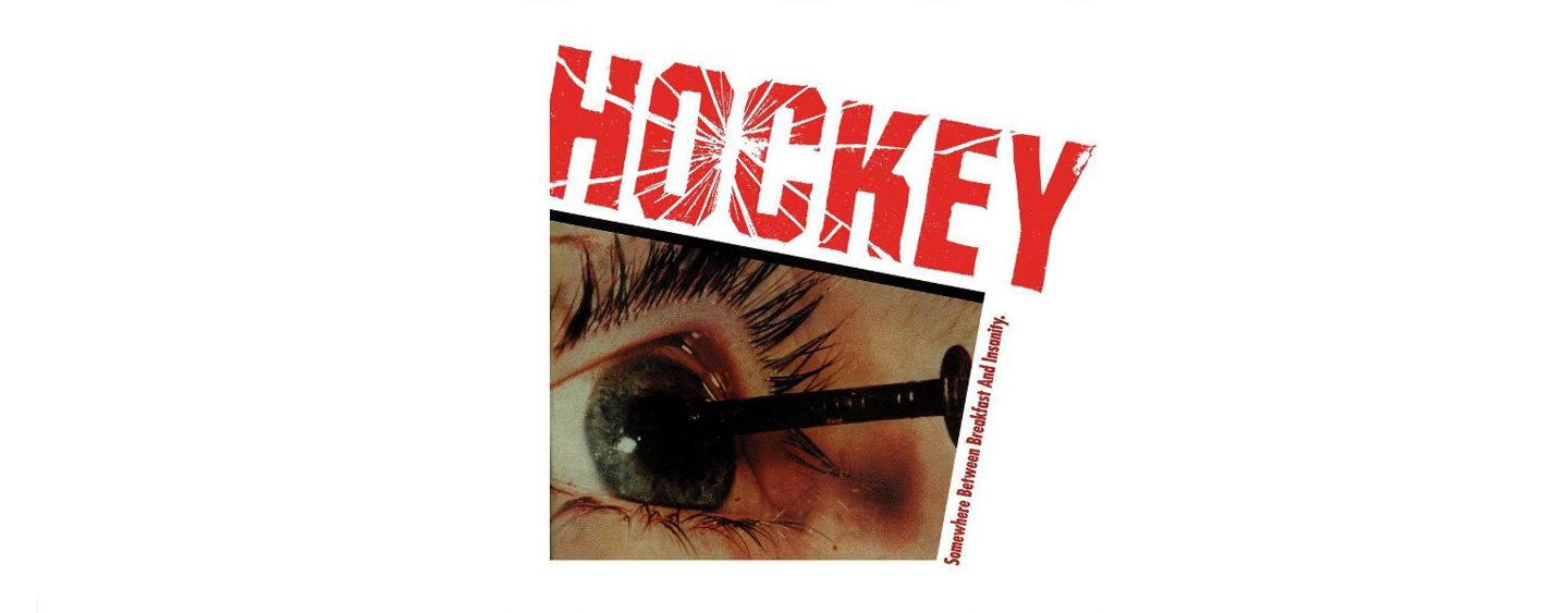 Needle in an eyeball, the Hockey Skateboards Logo and a subtitle saying: Somewhere between breakfast and insanity.